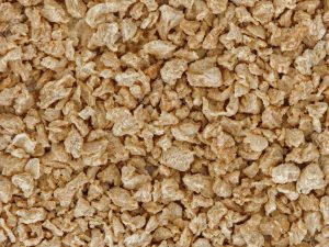 44231399 background of a lot of textured soy protein granules viewed from above